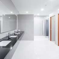 image of clean tile flooring in a bathroom of a commercial building